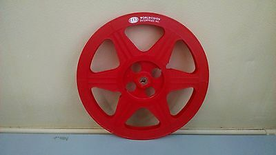 Two red plastic 16mm 1200ft reels with Worldvision Enterprises Logo