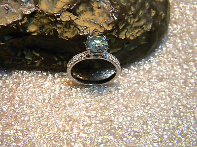 1.40 Ct. VVS1 Sky Blue Moissanite Set In A Pave Accent .925 Silver Ring Size US7