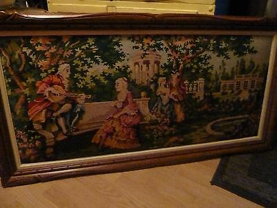 antique needlepoint picture in wooden frame