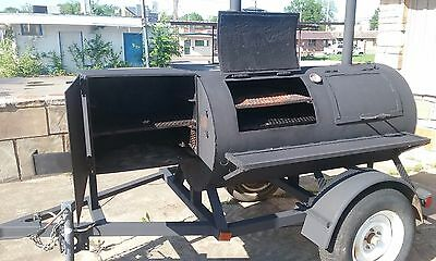 Charcoal  pit bbq wood smoker pull behind grill cooker trailer.