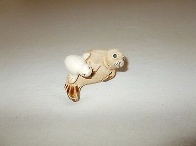 Small sized hand crafted mother seal and baby pup figurine