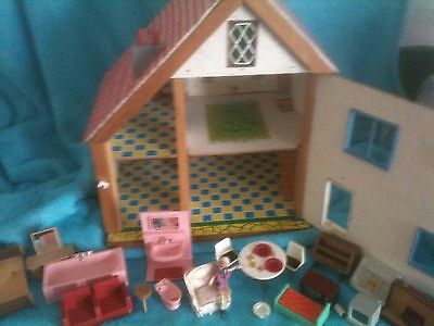 Vintage Dolls House 50s 60s, with some plastic furniture