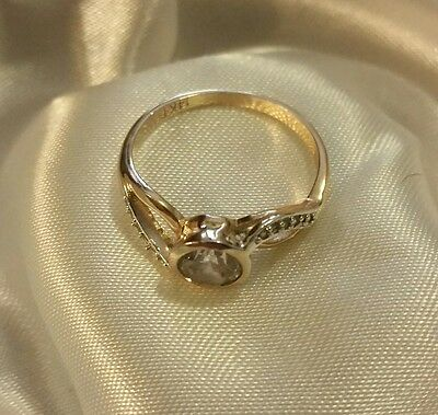 NEW. Pretty genuine 14ct yellow gold and CZ ring. Size 8/P.