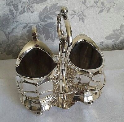 A Vintage Silver Plated Creamer and Sugar Bowl in a Stand, F.M & Co