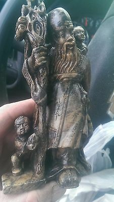 Antique chinese stone carving  old man with kids and cane.
