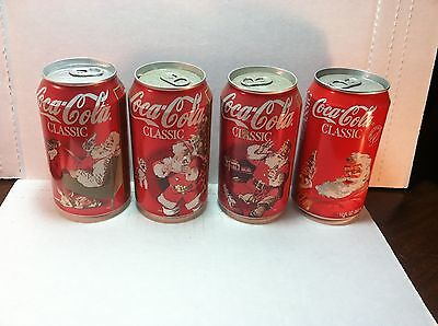 lot of 4 Coca-Cola Coke Christmas themed soda pop cans - 1986 & 1997
