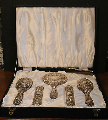 A Cased Silver Backed Six Piece Brush Set Floral & Swirls Birmingham 1976