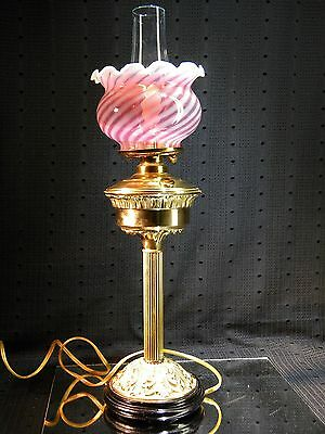Antique Brass Electrified Oil Lamp with Ruffled Cranberry Swirl Glass Shade