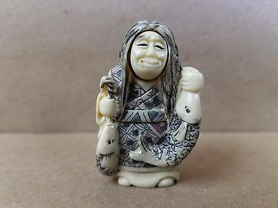 Antique Japanese Netsuke Carved Old Wise Man Movable Face Two Faces Holding Fish