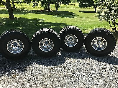 Pre owned Parnelli Jones Dirt Gripz 36x14.5x16  on M/T 8x6.5 Lug