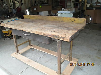 Vintage, old industrial 1900's work bench with cast iron legs