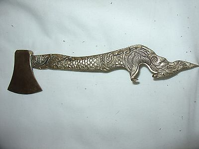 Solid brass dragon like head bottle opener with axe blade on the end.