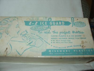 Vtg.collectable E-Z box of eight glass ice guard & drink markers