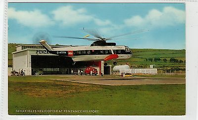 HELICOPTER AT PENZANCE HELIPORT: Scilly Isles postcard (C26610)