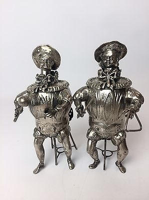 Pair of Continental Silver Seated Jesters With Wobbling Heads