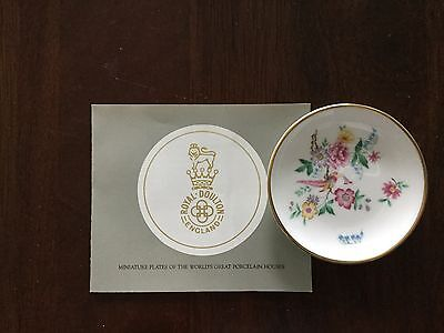 Royal Doulton butter pat, in perfect condition, comes with original box and COA