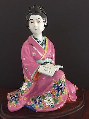 Japanese porcelain figure of a seated Bijin (beautiful woman)