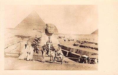 EGYPT -  Great Sphinx  & Pyramid, Tourists pose on Camel with Native Guide - RP