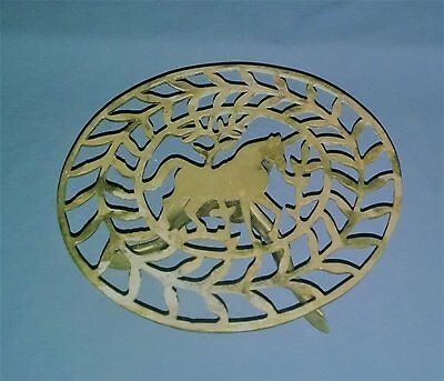 antique footed brass trivet with horse motif