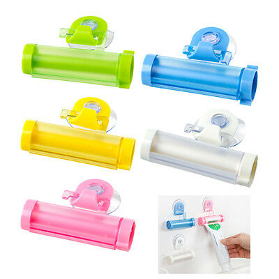 New Plastic Tube Toothpaste Dispenser Rolling Holder Squeezer Sucker Suction Cup