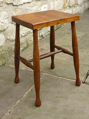 Victorian oblong topped stool on turned legs with cross stretchers. Elm + Beech.