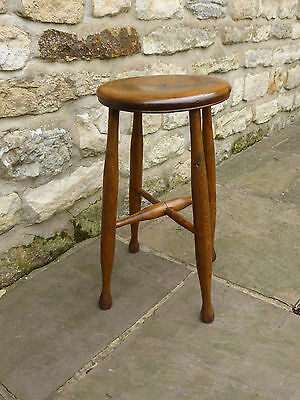 Victorian round topped stool on turned legs with cross stretchers. Elm + Beech.
