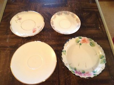 Lot of four small china plates