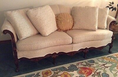 Antique Camelback Sofa With Ornate Carved Ball Claw Feet