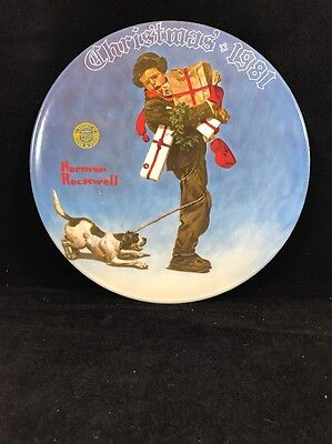 """Norman Rockwell 1981 """"Wrapped Up In Christmas"""" Plate by Knowles"""