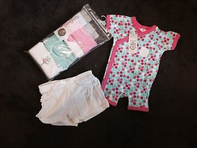 Mixed baby girls clothes. Includes singlets new in packet – 7 items. 0000 to 0