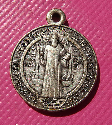 Ancient religious medal of the holy father Benedict and the cross of protection