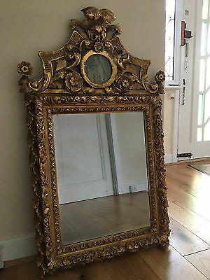 Large and elaborately carved antique Rococo giltwood Mirror