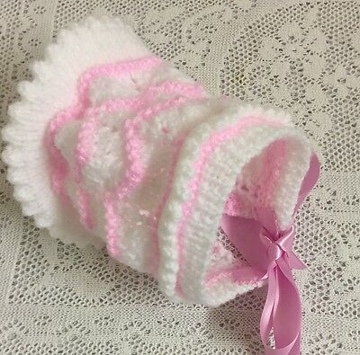 Handknitted baby bonnet, white with pink contrast poss fit 2-4 mths