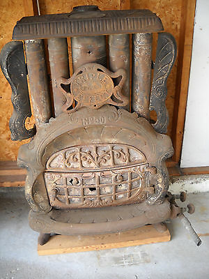 "Antique Parlor Stove, 1895, ""Triple Effect"""