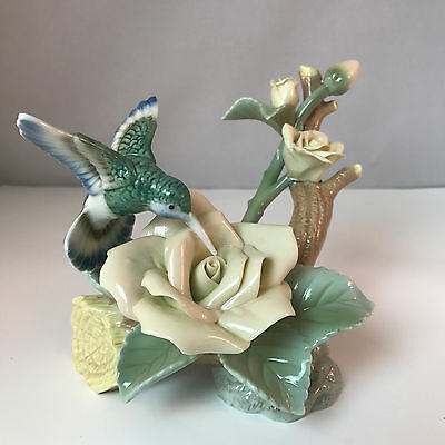 Blue Hummingbird And Pink Roses On A Tree Branch Porcelain Figurine