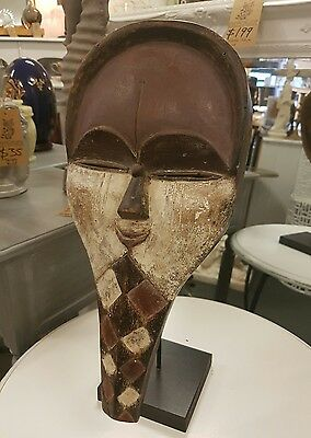 African Tribal Artifact. African Mask on stand