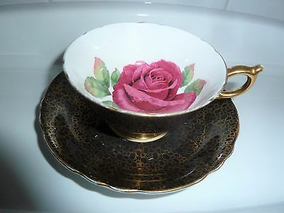 Paragon WARRANT by the Queen Tea Cup and Saucer  Set Cabbage Rose on Black/Gold