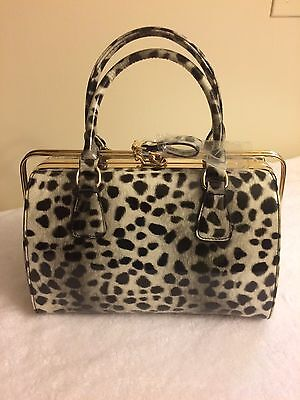 woman hand bags and jewelry