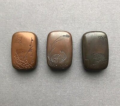 A Set of Three Antique Copper Japanese Carved Boxes