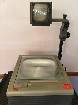 3m 9100 Overhead Projector supports two bulbs.Tested/Works /Fold down arm/ art
