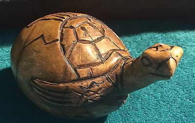 Carved Turtle Hatching Out Of Its Egg