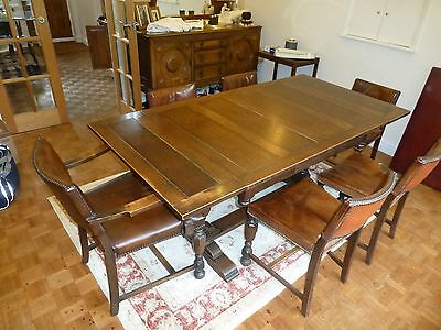 Antique solid oak dining table with expandable leaves and 6 chairs