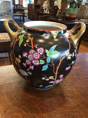 Pottery two Handled Jar With Flowers In A Black Background C. 1830