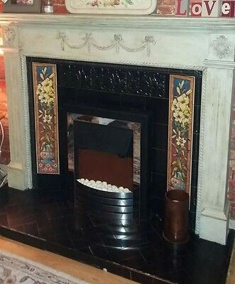 victorian fireplace with fire and hearth