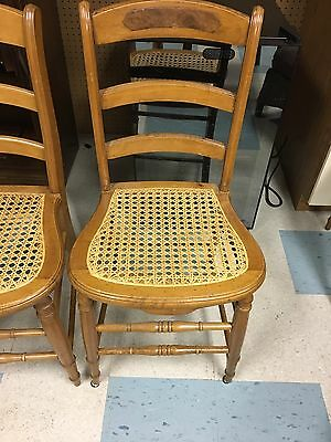Eight Antique Caned Chairs With Inlaid Wood