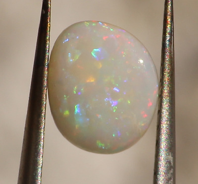 0,90 cts - Opale blanche de Coober Pedy - cabochon forme-libre - loose white cry