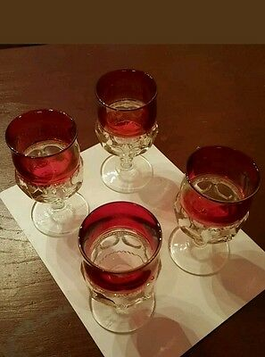 4 red colored wine glasses