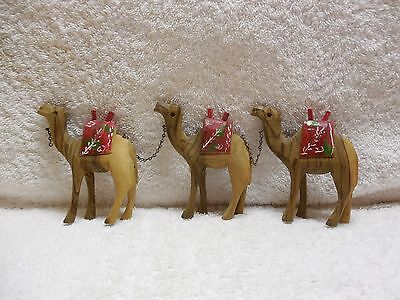 3 Wooden Hand Carved Camels With Decorative Hand Painted Saddles