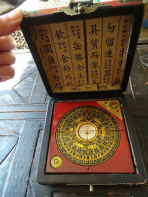oriental feng shui compass in red leather case with dragons