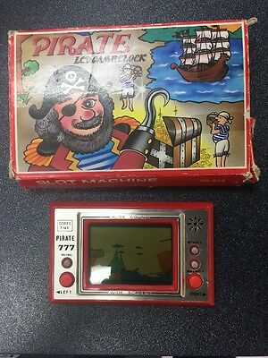 Vintage Pirate Lcd Electronic Handheld Game & Clock/watch 777 In Box/boxed/nos
